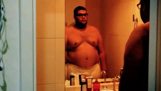 men standing in his boxers in the bathroom